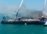 Enigma crew rescued from burning yacht
